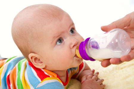 Little baby is feeding milk from bottle Stock Photo - 12365152