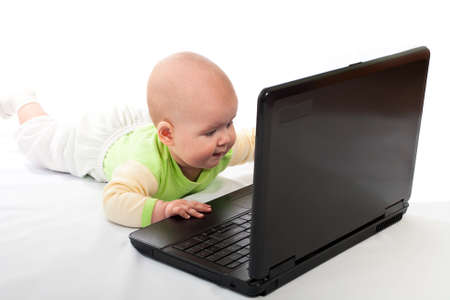 Portrait of little baby with laptop on white background Stock Photo - 12365171