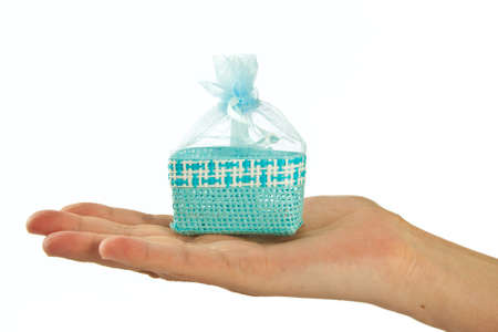 paperbag: Blue straw paper-bag on hand. Isolated on white background. Stock Photo