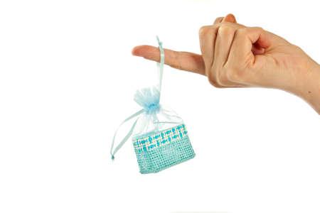 paperbag: Blue straw paper-bag on finger. Isolated on white background.