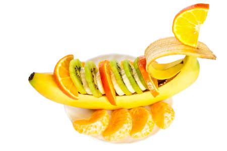 segmentar: Tallado de pl�tano, kiwi y el segmento de naranja