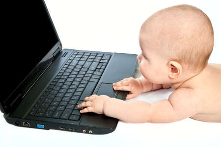 Portrait of a little baby with laptop  photo