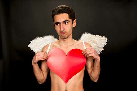 Portrait of glamour man with white wings and heart