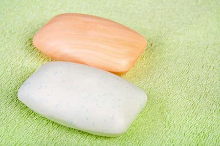 bathtowel: Two soap bars on green terry bath-towel