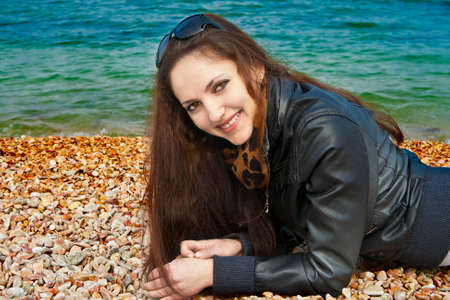 Portrait of young woman on the sea coast  photo