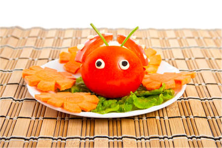 Carving from lettuce and tomato in form ladybird.