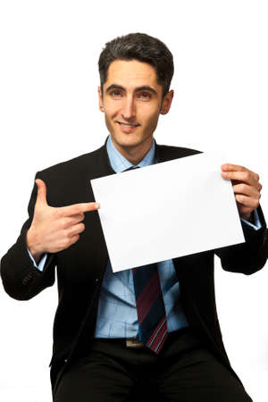 Young successful  businessman is showing the advertisement Stock Photo - 12979036