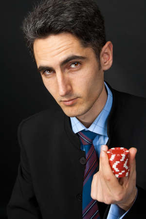 Young lucky gambler with chips in hand  photo