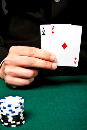 Chip and cards for the poker on the table. Stock Photo - 13185296