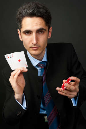 gambler: Young lucky gambler with cards and chips.