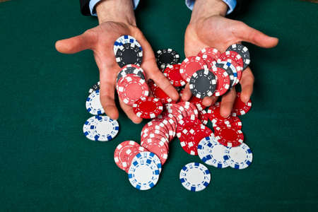 gambler: Young lucky gambler with chips in hand  Stock Photo