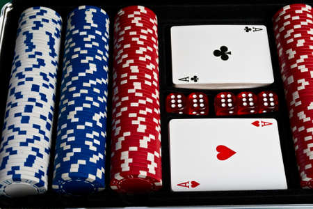 Set of chips; dices and cards for the poker in suitcase. Stock Photo - 13270007