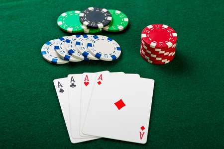 Chip and cards for the poker on the table.  Stock Photo - 13270082