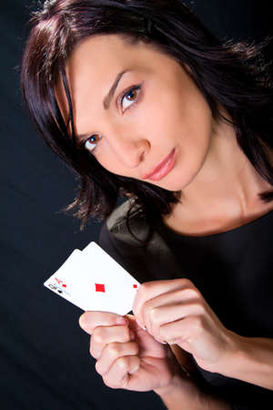 Young lucky gambler with cards in hand