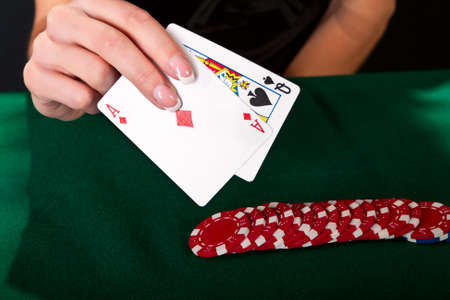 gambler: Young lucky gambler with cards and chips  Stock Photo