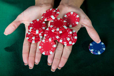 Young lucky gambler with chips in hand Stock Photo - 13417144