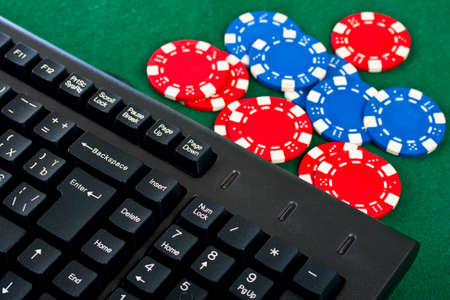 Fragment of the black modern keyboard of computer with gamble chips. photo