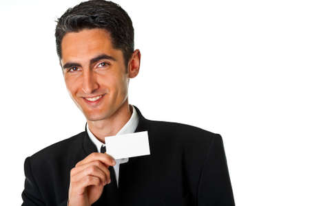 Young smiling successful business man with blank business card photo