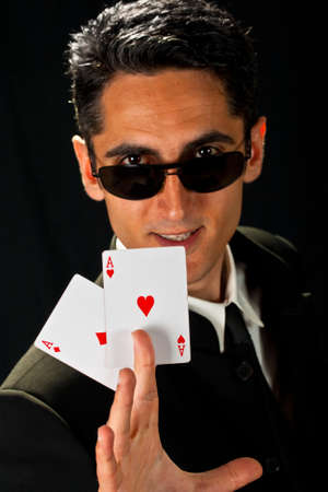Young lucky gambler with cards in hand Stock Photo - 13809267