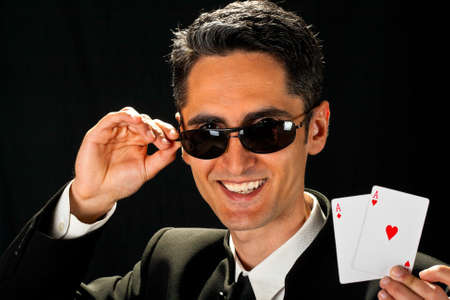 Young lucky gambler with cards in hand Stock Photo - 13809278