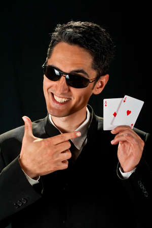 Young lucky gambler with cards in hand  Stock Photo - 13809271