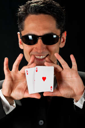 gambler: Young lucky gambler with cards in hand