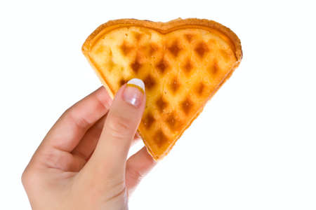 homemade waffles in the shape of  heart in hand photo