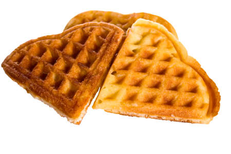 homemade waffles in the shape of  heart isolated on white background photo