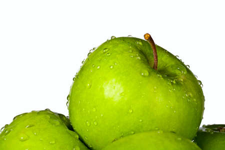 Group of green apples with water drops isolated on white background photo