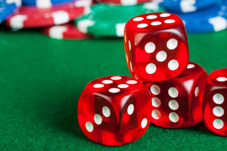 Group of chips and dices on the green cloth. Stock Photo - 16912090