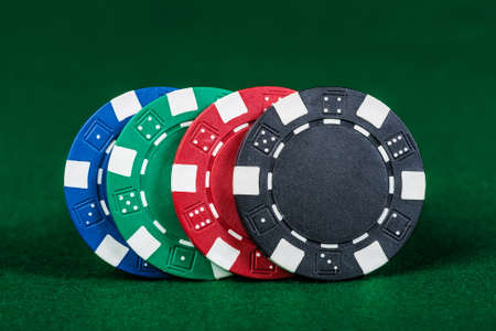 Group of poker chips on the green cloth  photo