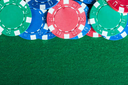 Group of chips on the green cloth Stock Photo - 17311699