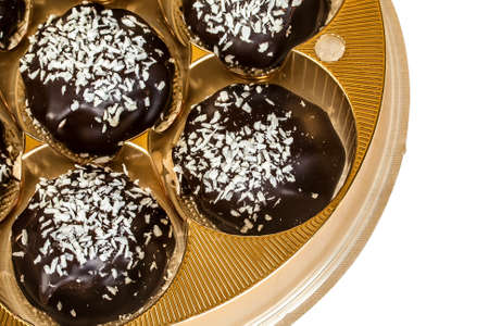 chocolates with coconut in a gift box gold photo
