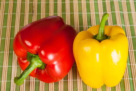 ripe red and yellow peppers on cloth straw Stock Photo - 18675695