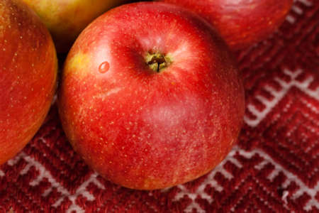 red apples on red tablecloth  country style photo