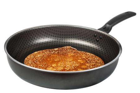 hot pancake in frying pan isolated on white background photo