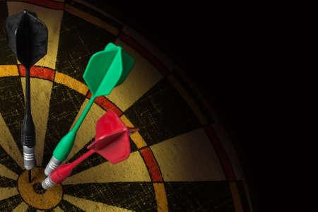 old dart board on dark background