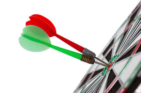 Two darts in center of target isolated on white Stok Fotoğraf