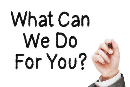 care providers: Man Writing What Can We Do For You Question Stock Photo