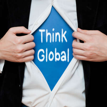 message text: Think Global Concept. Man Showing a Superhero Suit Underneath His Shirt With a Message Text Written On It.