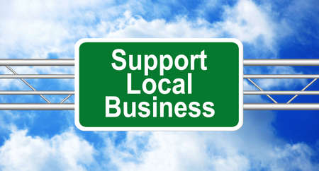 local business: Support Local Business. Road Sign with blue sky on background