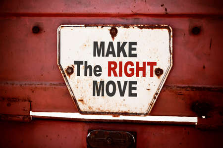 business advice: Make the Right Move. Message text written on iron board