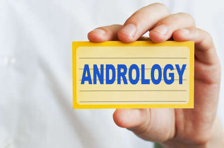 urologist: Andrology concept. Card with text in doctor hands Stock Photo