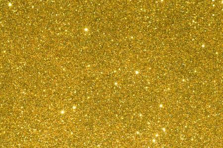 Shiny glitter background in gold color. Christmas decoration.