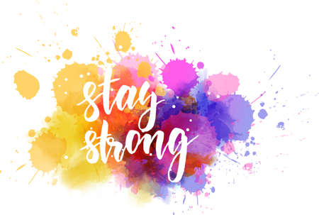Stay strong - handwritten modern calligraphy lettering text on multicolored watercolor paint splash.