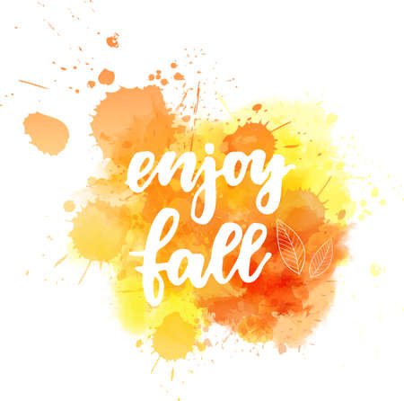 Enjoy fall - handwritten modern calligraphy lettering on abstract watercolor splash. Season illustration. Orange colored.