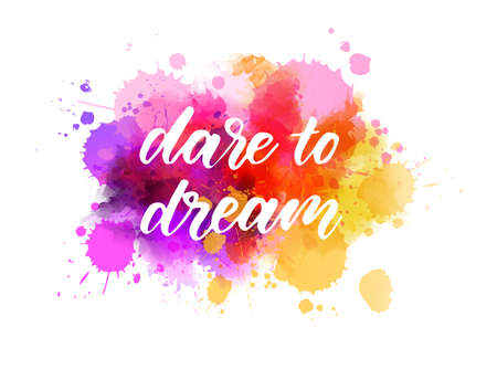 Dare to dream - motivational message. Handwritten modern calligraphy inspirational text on pink and purple colored watercolor paint splash.