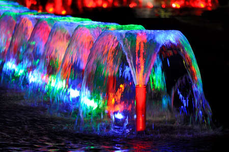 Colorful Water Jets of Wine-Glass Shape Fountains in Victory Park Stock Photo