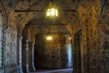 = Old Lights in the Interior Gallery of St. Basil's Cathedral =Spectacular interior of the gallery (one of the corridors which make a circle around the central tower and bind all chapels together) of St. Basil's Cathedral covered with delicate floral de