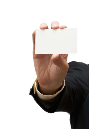 Business man handing a blank business card over white background photo